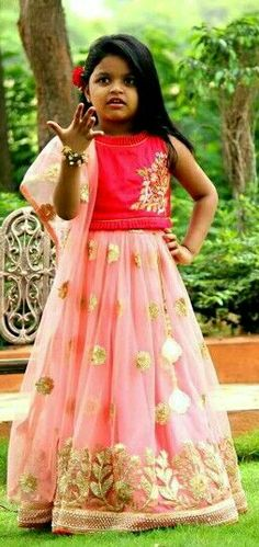 Kid in pink lehenga.......