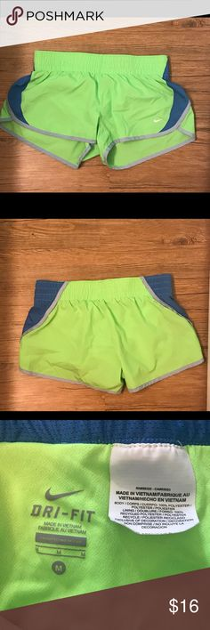 "Nike Dri-Fit Shorts Size M Electric Green Nike Shorts With Blue And Gray Accents. Size M. Measures 14.5"" across the waist and 9.5"" from waist to hem. Great condition! Nike Shorts"