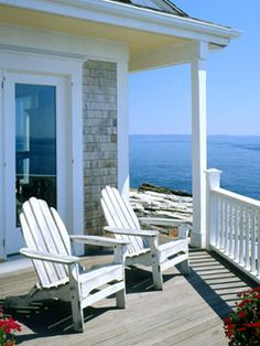 With a view like this one, we don't care how cute the inside is, who would want to ever leave the front porch? These chairs, similar to these Cedar Adirondack Chairs, add a classic chic touch to this deck, featured in Coastal Living