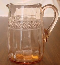 Pink Depression Glass Pitcher with an Etched Design