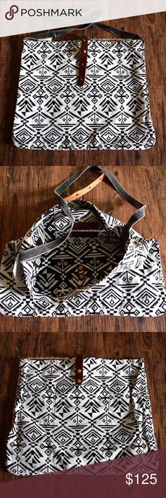 "TRIBAL TOTE Printed Crossbody Saddle Tapestry Mini One Size. New with tags.   - Beautiful slouchy tribal inspired bohemian Crossbody bag featuring leather closure with adjustable button options . - 70's ethnic inspired aspect brings character. - Roomy and practical.  - Interior pockets. Very spacious!   Cotton, Leather.  Imported.    {Southern Girl Fashion - Closet Policy}   ✔Bundle discount: 20% off 3+ items.   ✔️ Reasonable offers are considered when submitted using the ""offer"" button.   ❌…"