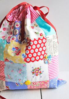 Pretty bag by Helen Philipps with embroidered posy, buttons and suffolk puffs.