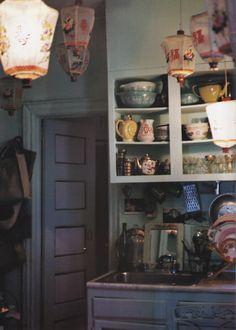 Marie Anne Oudejans Kitchen (founder of Tocca)  Mismatched vintage crockery & chinese lanterns
