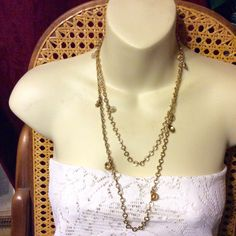 A personal favorite from my Etsy shop https://www.etsy.com/listing/276360336/vintage-gold-chain-with-swirl-disc