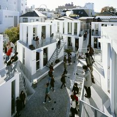 Outdoor shopping mall, Sarugaku, in the Daikanyama district, which accomodates six buildings and ten retailers on less than six thousand square feet; architect Akihisa Hirata does so by means of compression, allowing shops to sit atop one another and relying on shoppers and storefronts to fill an otherwise unadorned public space. Follow us for more daily updates at www.pinterest.com/pilkingtonglass | Tags: #Architecture #Tokyo