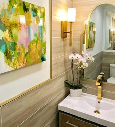renovated bathroom with brass moroccan mirrors and wall sconces