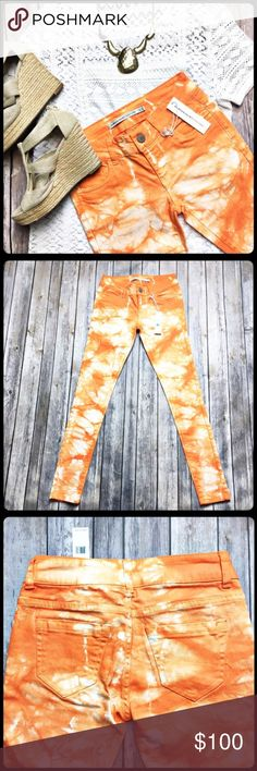 "Funky Tie Dye Romeo & Juliet Couture Skinny Jeans Make a statement in these jeans!  Brand new orange tie dye skinny jeans by Romeo & Juliet Couture.  Very stretchy being made of 98% cotton and 2% spandex.  Measurements laid flat: waist 13"" hip 15 1/4"" thigh 7 1/2"" ankle opening 4 1/2"" and inseam 29"". (Shirt in covered for sale in this closet. Other items featured not for sale.) Romeo & Juliet Couture Jeans Skinny"