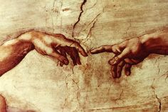 Partial Photo of The Creation of Adam: By Michelangelo on the ceiling of the Vatican.
