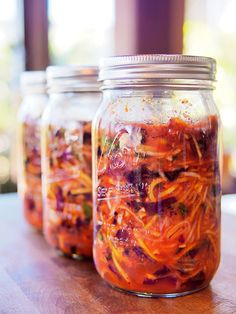 """Red Cabbage Kimchi- 2lbs red cabbage, 1/4c salt, 1/2lb daikon, 1/2lb carrot, 6 green onion, 1"""" piece ginger, 4 cloves garlic, 1 asian pear (?), 1/2c korean red pepper powder, 1c water, 2T fish sauce."""