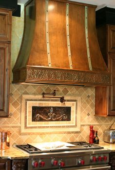Poplin hood-Aged copper hood with decorative molding, stainless steel strapping and dads