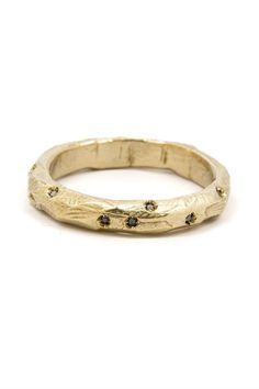 Hand carved in wax and cast in recycled brass, the nugget ring is perfect for stacking. Details: Brass. Black diamond. Energy and precision unite in the natural world. Kristina Kada's handcrafted jewe