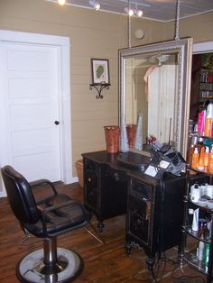 I love the vintage desk and the mirror hanging from the ceiling! Coolness!