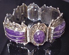 This ponderous bracelet is simply spectacular and is crafted from the highest 980 grade silver, which is greater silver content than 925 sterling. This elegant piece is in superb condition and has 7 impressively large amethyst stones – cabochons and expertly-carved insets. It is circa 1920-1930's