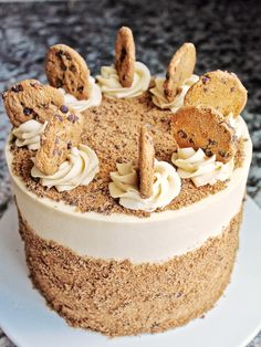 Tender yellow cake layers baked on a chocolate cookie crust, filled with a brown sugar buttercream and covered in chocolate chip cookie crumbs.