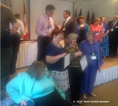 """Crossing the stage for the """"Triple Crown Repeaters"""" award, following after my mentor, Joe Grondin, on the stage, at the District 45 Toastmasters 2016 Spring Conference, May 20-22, 2016.  In front of stage are Wendy Harding, Heather Perkins, and Candace Buell - all Past District Governors."""