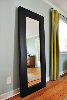 I love giant mirrors {or art} that are leaned against the wall ...