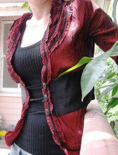 Gorgeous upcycled jacket. Possible closure idea for too-small jacket.