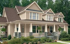 Craftsman Home - Craftsman homes display a return to a simpler, more modest style of architectural design. They are relatively small and intimate, with low, gabled roofs with large overhangs, and wide front porches anchored by tapering posts.