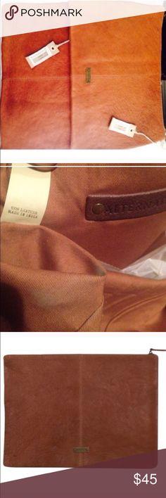 Alternative Apparel - 100% genuine leather bag I use mine as a clutch and laptop bag, fits my 13inc mac book Alternative Apparel Bags