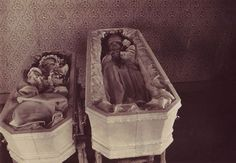 An authentic postcard showing two sisters laid out in matching coffins. An inked inscription verso in a fine period hand identifies the girls as Claudia Severine Groth / Born Sept. 30, 1908 / Died Feb. 20, 1911 and Millie Cecelia / Born Dec. 25, 1910 / Died Feb. 21, 1911