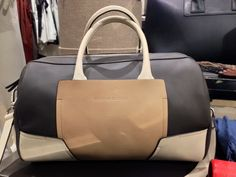 Tonal cream and black blocked women's handbag for spring 2014 from Brunello Cucinelli.