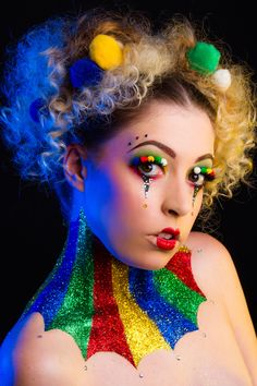 Photography: www.luiscruzphotography.co.uk Hair and Make-up: www.thewhiterabbitmakeupartist.co.uk Glitter Sponsor: www.peaceloveglitter.co.uk Model: www.instagram.com/jadekazee/ Circus | Funfair | Make-up | Clown | Glitter Ruff | Glitter Makeover | Theatrical | Pom Poms | Chopstick Hair | Event Makeover | Fairground