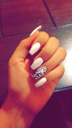 cool White and black coffin nails with design...