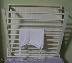 Re-purposed crib parts into a drying rack for the laundry