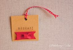 By Pokeberry Ink Press: Set of five kraft paper gift tags dressed with a red felt bow and red ribbon. $10