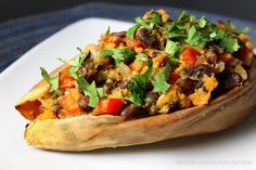 Southwestern baked sweet potatoes loaded with black beans, peppers, onion, green chiles and lime. Clean eating approved!