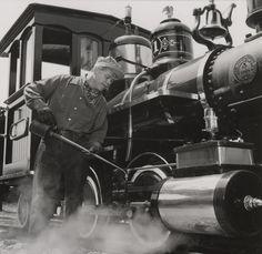 """133. Ward Kimball oiling up his train """"Chloe"""", 1958."""