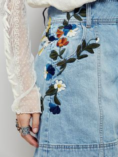 Jackson Embroidered Denim Skirt | This vintage-inspired denim mini skirt will have you dreaming of days past. Featuring floral embroidery along the hips and button detailing up the front. Rigid cotton fabric and A-line silhouette with hip pockets. Easy, effortless fit.