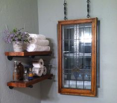 Refurbished stained glass window and slab shelves/black pipe supports.