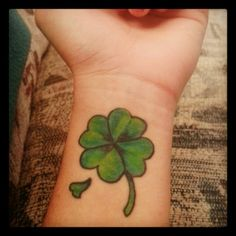 Four-leaf clover tattoo. I want this minus that extra little piece.
