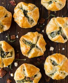 The best Spinach Puffs for your holiday parties! This easy puff pastry appetizer is filled with cream cheese, spinach, feta, and bacon, for a delicious snack that tastes like everyone's favorite spinach dip.