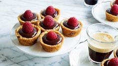 These cookie cups made with Betty Crocker™ chocolate chip cookie mix, filled with creamy ganache and topped with raspberries are the perfect mini indulgence!