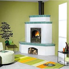corner wood burning stove. Like this idea and the wood storage beneath, not so much the colors