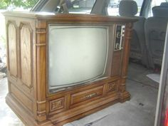 Huge Wooden TV Sets - no remotes, that's because the kids were the remotes, we had to get up and turn the channel! lol