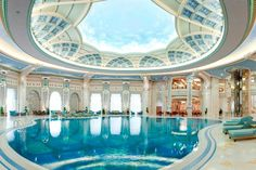 luxury indoor pool design with round ceiling
