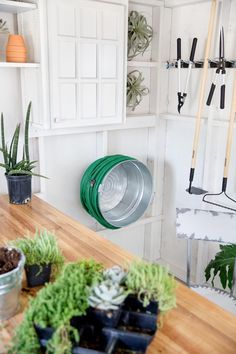Just steps away from the front door, the build and design team transformed an unused shed into a charming spot for potting plants and storing garden tools. >> http://www.diynetwork.com/blog-cabin/2016/garden-shed-pictures-from-diy-network-blog-cabin-2016-pictures?soc=pinterest