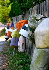 Decorate cottage fence with buoys for that nautical look. Coastal Homes, Coastal Living, Key West Style, Lakeside Living, Nautical Looks, New England Style, Sand And Water, Beach Shack, Beach Design