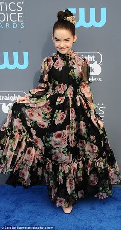 Love of floral: Amy Landecker cut a chic figure in her one-shouldered look while Mckenna G...