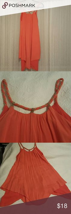 Dress This dress size runs between small and medium it's a very fluffy dress very comfortable and the color is more coral than orange. Dresses