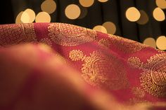 A majestic red Kanjivaram with taditional motifs across the expanse of the sari.