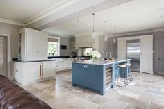 This six bedroom farmhouse kitchen has been extended to provide a large family kitchen with central island, a beautiful glazed orangery with feature domed ceiling provides the dining area and an open-plan snug with large stone fireplace. The brief was to bring the whole space together with a classic design which would be sympathetic to …
