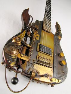 """GUITAR: The Instrument That Rocked The World,"" the traveling exhibition of The National GUITAR Museum! Only Steampunk guitar in the museum."