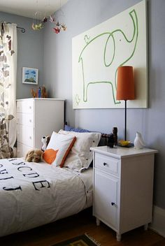Orange and Grey big boy room facelift - very cute. Love the elephant