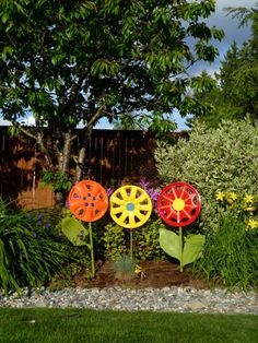 While you wait patiently for spring, make your own flowers using hubcaps and broken shovel handles!