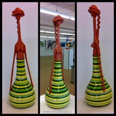 Bottlegirl clay figure made with an old bottle www.michaelart.nl
