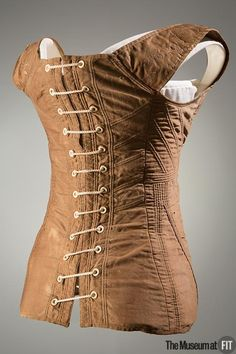 """An 1811 fashion article described """"a short corset, fitted exactly to the natural shape"""" as the ideal style to wear beneath the high-waisted, """"Grecian"""" gowns of the early nineteenth century. Vintage Corset, Vintage Underwear, Vintage Lingerie, Grecian Gown, Regency Dress, Regency Era, 19th Century Fashion, 18th Century, Museum"""